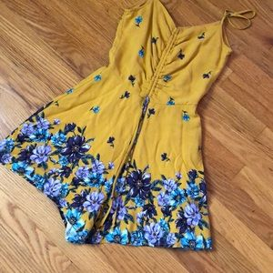 Mustard Romper with purple and blue flowers